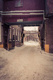 Snowy Industrial Alleyway Stock Image
