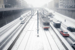 Snowy inner city car and tramway traffic Royalty Free Stock Photography
