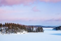 Snowy islands of Saimaa lake. Finland, winter. Snowy islands of Saimaa lake. Rural winter landscape, Finland royalty free stock photography