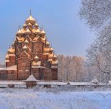 Snowy January morning in Nevsky forest Park. St. Basil`s Cathedr. Snowy January morning in Nevsky forest Park. The Bank of the river Neva royalty free stock image