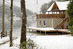Snowy Lake. Boathouse at Lake Burton on a gray, snowy day stock image