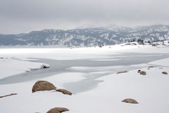 Snowy lake in Pyrenees. Snowy lake of Bouillouses in Pyrenees Orientales,Capcir,Languedoc-Roussillon region of France Royalty Free Stock Image
