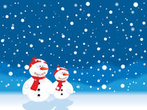 Snowy landscape. Snowy winter landscape with snowman couple Royalty Free Stock Image