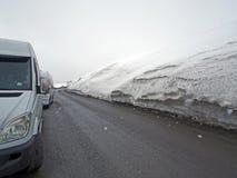 Snowy landscape along the Georgian military road in the spring. Snowy landscape along the Georgian military road in spring during a snowstorm, snowdrifts on the stock photos