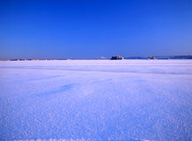 Snowy landscape and blue sky Stock Photos
