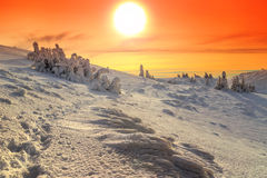 Snowy landscape with colorful sunset,Carpathians,Transylvania,Romania,Europe Stock Photo
