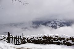 Snowy landscape with fog and grey sky. Royalty Free Stock Photography