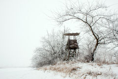 Snowy landscape with a hunting hide Royalty Free Stock Photo