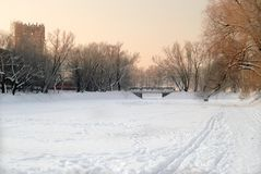 Snowy landscape of lake with bridge in evening. Snowy landscape of lake with bridge Royalty Free Stock Photo