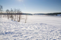 Snowy landscape by lake Stock Photography