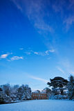 Snowy landscape with manor house Stock Photos