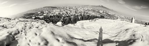 Snowy landscape with Nitra city, Slovakia, colorless. Snowy landscape with Nitra city, Slovak republic. Panoramic photo. Beautiful seasonal scene. Black and Royalty Free Stock Image