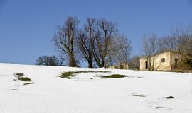 Snowy landscape with ruin of a farm building Royalty Free Stock Images