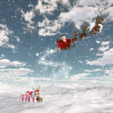 Snowy landscape with santa and his reindeers Royalty Free Stock Images