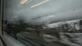 Snowy landscape seen from the train stock footage