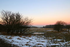 Snowy landscape at sunrise Stock Photography