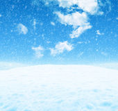 Snowy landscape under a blue sky. White snowy landscape under a blue sky with light clouds Royalty Free Stock Image