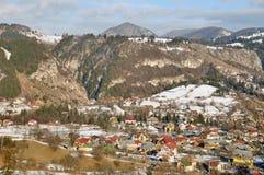 Snowy landscape village Stock Images