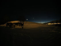 Snowy landscape with whale island settlement at night Stock Images