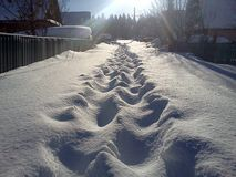 Snowy lane in suburban village Royalty Free Stock Photos