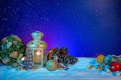 Snowy Lantern with Fir Branches And Baubles on Christmas banner royalty free stock photography