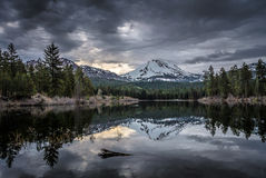 Snowy Lassen Peak and Manzanita Lake, Lassen Volcanic National Park Royalty Free Stock Images