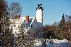 Snowy-Leuchtturm Stockbilder