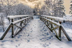 Snowy little bridge. Snowy, wooden bridge in a winter day. Stare Juchy, Poland Stock Images