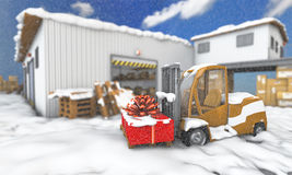 Snowy loader with gift Royalty Free Stock Photos