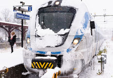 Snowy local train has arrived at its final destination on a winter day. Stockholm, Sweden - November 9, 2016: Snowy local train has arrived at its final royalty free stock photos