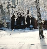 Snowy lodge in the winter forest Royalty Free Stock Photos