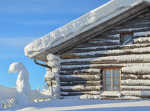 Snowy log cabin Stock Photography