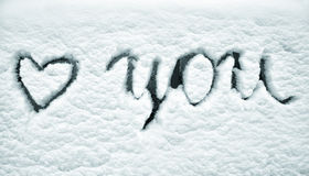 Snowy love you sign on window background Royalty Free Stock Photography