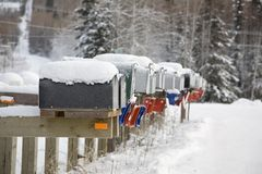 Snowy mail boxes all in row Stock Photos