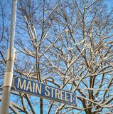 Snowy Main Street. A Snowy Main Street Sign In Small Town America Stock Photo