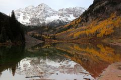 Maroon Bells reflected in the Maroon lake at sunrise in the Fall royalty free stock images