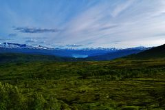 Snowy meadow. Meadow with snowy mountains and a fjord in Norway Royalty Free Stock Image