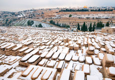 Snowy Memorial Jewish cemetery on the Mount of Olives. Ancient cemetery on the Mount of Olives slope straight into the Kidron Valley Stock Photos