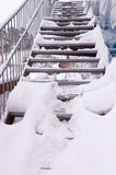 Snowy metal stairs. Metal stairs outside covered by snow in winter Stock Photos