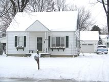 Snowy Michigan House. A cozy little home on a typcial cold Michigan winter day Stock Photography