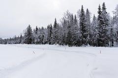 Snowy motor road Royalty Free Stock Photo