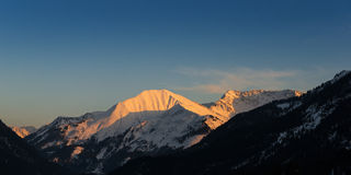 Snowy mount bleispitze at sunset sun Stock Photo