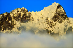 Snowy Mount Si Rising from Clouds North Bend Washington Stock Photo