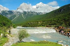 Snowy mountain. Landscape of snowy mountain and white water in Li Jiang, China Stock Photos