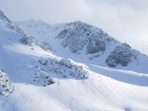 Snowy Mountain. Fresh Snow on Some Very Tall Mounatins in the Winter royalty free stock photography