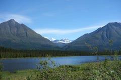 A snowy mountain against a blue sky. Royalty Free Stock Photos