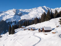 Snowy mountain chalet in wood Stock Images