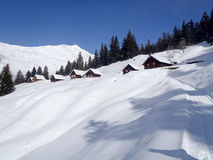 Snowy mountain chalet in wood Stock Image