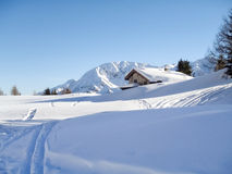 Snowy mountain chalet in wood Stock Photos