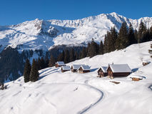Snowy mountain chalet in wood Royalty Free Stock Photos
